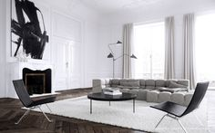 London-based interior designer Jessica Vedel designed this black and white Parisian apartment that has classic architectural details and modern furnishings. The abstract painting above the fireplace sets the tone of bright, open living room.