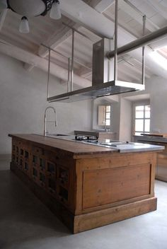 I love this old piece of furniture that has been made into a kitchen island with half wood and half worktop where the sink area is.