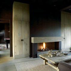 chunky wood mantel, stucco walls