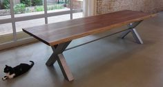 Reclaimed black walnut dining table by moss Design.