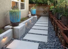 The new path combined with a retaining wall and pot/firewood wall meets all the requirements.
