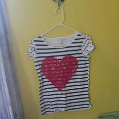 Heart T-Shirt Red lace heart on the front with black stripes. Black hearts cover the back of the shirt. Never worn but doesn't have the tags on them anymore. Perfect Condition!   No trades but willing to negotiate!! Elle Tops Tees - Short Sleeve