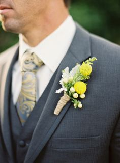 colors-dark gray, dusky blue (tie) and yellow? Groom in suite, groomsmen in vest w/out jackets.