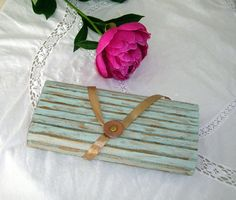 Cardboard penholder painted in blue with golden effect, leather pastille and satin ribbon