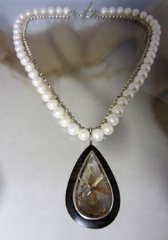 Atelier Femke Boschker, necklace. Silver, fresh water pearls, brown ebbony, starrutile quartz