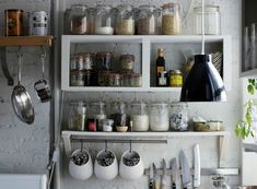 Great storage for a tiny kitchen! /  http://www.ruemag.com/decor-inspiration/clever-utensil-storage  Hanging jars, etc.,  are IKEA's Fintorp series:   http://www.ikea.com/us/en/catalog/categories/series/21592/