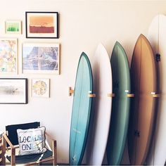 Surf racks at Mollusk in SF. Like the arm idea and keeping them at an angle.