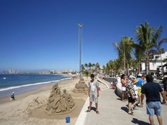 """This is the Malecon - or the """"boardwalk"""". the esplanade by the water front. They have shops and eateries all along - and the sculptures! I read it's best to go early in the day before it gets super crowded. Sand Sculptures, Sculpture Art, Usa Holidays, Thing 1, Local Attractions, Puerto Vallarta, Vacation Places, Walking Tour, Night Life"""