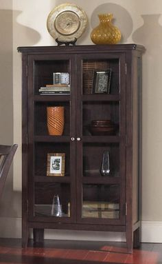 Arrange items in cabinet on either side of the doors. SWEET.....there's a blanket on the bottom shelf!