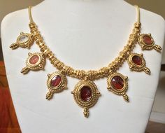A gold and silver ancient revival style necklace set with 7 genuine ancient hardstone intaglios