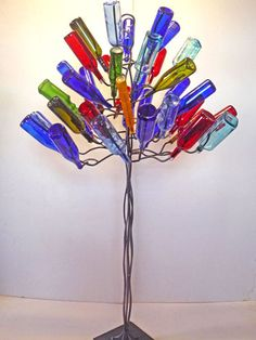 The Eudora: Large Bottle Tree, suggested for businesses, parks, public and private gardens. Stephanie Dwyer does a lot of custom work. Reuse Bottles, Bottles And Jars, Glass Bottles, Blue Bottle, Bottle Art, Bottle Crafts, Wine Tree, Wine Bottle Trees, Parks