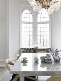 white / marble / ceiling light / pieces of china / dining Room / photo Marcus Lewett