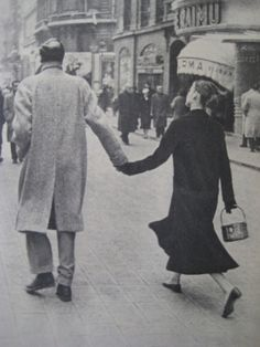 Audrey being led happily along by Mel, most likely in Rome. (Candid) Date: c.1959.