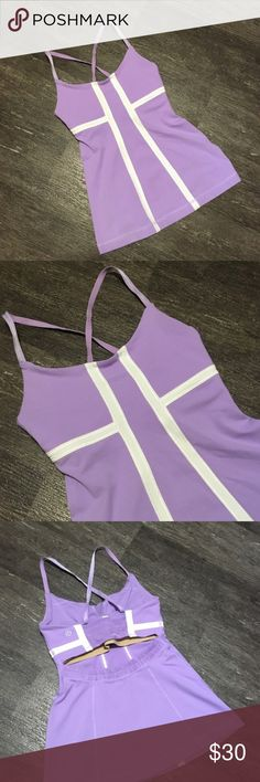 """Lululemon Top Lavender Peep Hole Racer Back Tank with white trim by Lululemon. Missing size tag, fits an XS. Built in sports bra with pockets for padding, but padding isn't included. Bust 24"""" lying flat, stretches to 30"""". Waist 22"""" lying flat, stretches to 28"""". Shoulder to hem length 22"""". lululemon athletica Tops Tank Tops"""