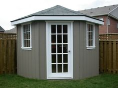 DIY corner shed. exchange the white trim for teal! sooo pretty!
