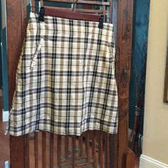 """Fun Plaid Skort - Super Comfy! Yep, a skirt and shorts all in one! This is a figure flattering Skort! Two small pockets in front, one in back; side slits; side zipper; and 2"""" of elastic on either side of waist assures that great fit! 97% Cotton, 3% Spandex. Line Up Skirts Midi"""