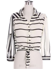 Vanilla Monkey---Stripe Print Blouse!  Feel ultra stylish and classy with this gorgeous stripe print blouse featuring a tie front and button tab on the sleeves. This blouse is available in Small, Medium and Large. 100% Polyester. $29.99