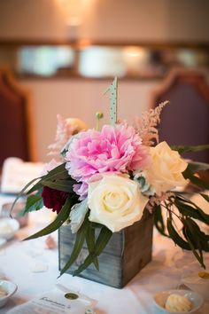 Simple and sweet table number & floral centerpiece designs.