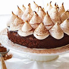 This Hot Cocoa Brownie Cake with Marshmallow Frosting is inspired by the classic winter drink. More of our best chocolate cake recipes: http://www.bhg.com/recipes/desserts/cakes/chocolate-cakes/?socsrc=bhgpin072913hotcocoacake=4