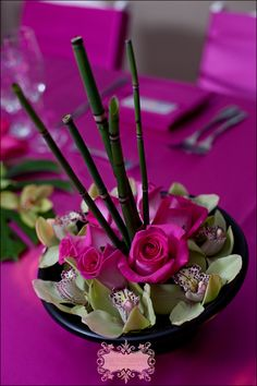 Orchid and bamboo centerpieceeat for asian theme event asian inspired centerpiece with dahlias bamboo orchids and roses events in bloom junglespirit Image collections