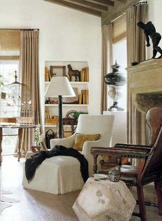 love the chairs...and the birdcage, fireplace, stone table, built-in bookshelves, ceiling