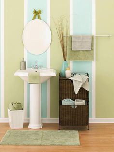 Wake Up Your WallsWake Up Your Walls  Painting is always a simple do-it-yourself weekend project that can transform a room. Buy mold- and mildewproof primers and paints. Create a spa mood with watery blues, greens, and neutrals. Add more color with towels, soaps, and candles.  The idea, but not these colors