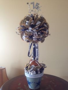 Made this topiary money tree for a 75th birthday celebration.  Dallas Cowboys fan.