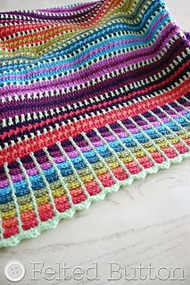 With a sweet rainbow of happy color and simple stitch repeats, this blanket is perfect for a quick project as a gift or for yourself. I love this! I can't wait to try this pattern myself!