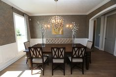 Dining Room in JV Model Home #dining #room #jerome #village #model #home #trim #wainscoting #chair #railing #interior #design #hardwood #flooring #window #windows #textured #wall #painted #door #doors #3 #pillar #homes #plain #city #ohio #dublin #schools #custom #luxury #dream #real #estate #builder #idea #ideas