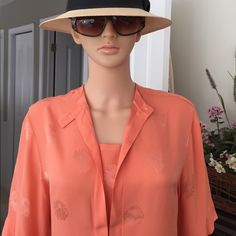 """💐KARL LAGERFELD  couture 100% silk blouse Like new, Karl Lagerfeld (designs for Chanel and Fendi) 100% coral colored couture silk blouse. Styled in an Oriental fashion, silk on silk with embossed pattern. Pls see photos, (camera is not picking up quality of silk and design) Excellent condition, Size 8 US. Top to bottom 27"""", shoulder to cuff 12"""", chest 20"""", shoulder to shoulder 18"""", No trade, no pp, smoke and pet free environment. Karl Lagerfeld Tops Blouses"""