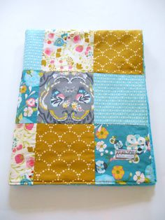 Minky Baby Girl Patchwork sewn in Art Gallery's new Emmy Grace line. Lots of butterflies, flowers and geometrics in this coverlet. Backed with Shannon Fabrics' Bubble Dot Minky in Teal and interlined with Warm & Natural cotton batting. In my shop now.