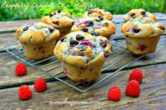 Fresh raspberries provide a sweet-tangy contrast to chocolate in these more-ish, moist and totally scrumptious muffins! Great for breakfast or anytime you feel like snacking. #raspberry #chocolate #muffins