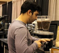 Buddy Brew going for the hand-tamping approach in Bout #4. #Coffee Best Espresso Competition
