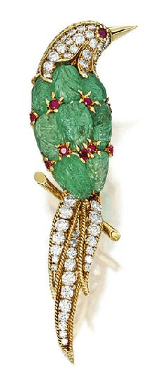 A carved emerald, ruby and diamond bird brooch by Van Cleef & Arpels, New York, Circa 1964.