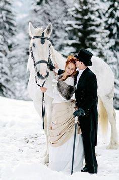 Bride and groom with horse #winter wedding #snow wedding