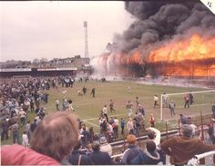 Main stand engulfed in flames in the Bradford City stadium fire which killed 56 people, 11 May 1985