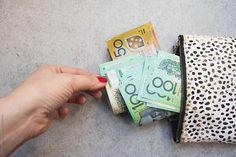 Australian money in 100 and 50 dollar bills by Natalie JEFFCOTT - Stocksy United