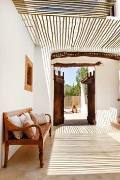 slender branches laid on a wire support system as shade structure ChicDecó: | A charming rural house in Formentera