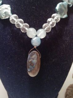 Opal, dragon vein agate, crystal quartz, and blue pearl