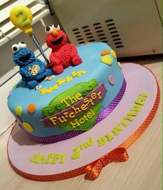 Furchester Hotel themed cake elmo and the cookie monster happy 2nd birthday colourful Chelsie Cook's Cakes