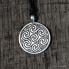 This Celtic pendant is decorated with triskele motifs, which are inspired by ancient Irish art.