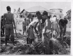 Japanese Prisoners of War TABLES TURNED ------------------------- Japanese soldiers clean Singapore street under supervision of their own officers. They were guarded by Indian and British troops. Bataan Death March, Afrika Korps, Iwo Jima, Free In French, East Indies, Singapore Travel, Prisoners Of War, North Africa, Armed Forces