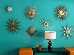 Teal walls with atomic wall decorations. Home inspireation