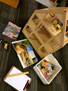 Construction/simple idea but fabulous add a ruler, home design magazines and a clip board to the doll house area great way to spark young architects