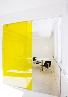 Office space white and yellow~concept for bold door to meeting/conference rooms.