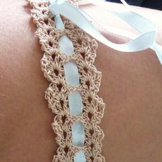 This crocheted wedding garter is the perfect heirloom gift for the bride-to-be. Made to measure or a generic size, I can personalise the thread colour and ribbbon to one of your choice, so it really can be a new and blue garter-perfect to hand on to the next bride as 'something borrowed'!