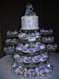 Cupcake wedding cake - Royal icing pansies and butterflies on cupcakes.  They look lovely on three tiered glass dessert trays.  I added two more glass plates to the center one and added hanging jewels.