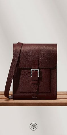 Shop the Chiltern Small Messenger in Oxblood Natural Grain Leather at Mulberry.com. The Small Messenger was designed as a nod to Mulberry's early iconic satchels, modernised with accessible yet subtle external pockets and finished in classic veg tanned leather.