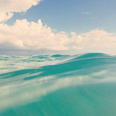 the ocean. clear water. summer. beach hair. sand in my toes.