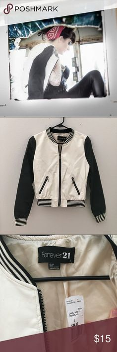 """Black and White Faux Leather Varsity Jacket Purchased this and used once for a photo shoot (pictured). Tags are still attached. Thought I would wear it later but never did. It's wrinkled from storage and could use a good cleaning- has been in storage for years. Size Small. Measurements laying flat : chest 18"""", length 20.5"""", arm Inseam 18.5"""". Side pockets. Stripe cuffs and waist band. All zippers functioning. Now flaws besides the wrinkles. Color is ivory and black. Has beige lining. Forever…"""